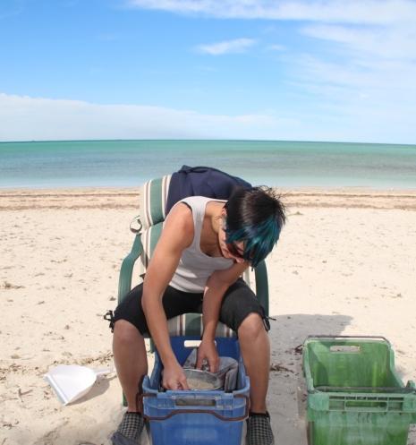 kirsten sifting sand
