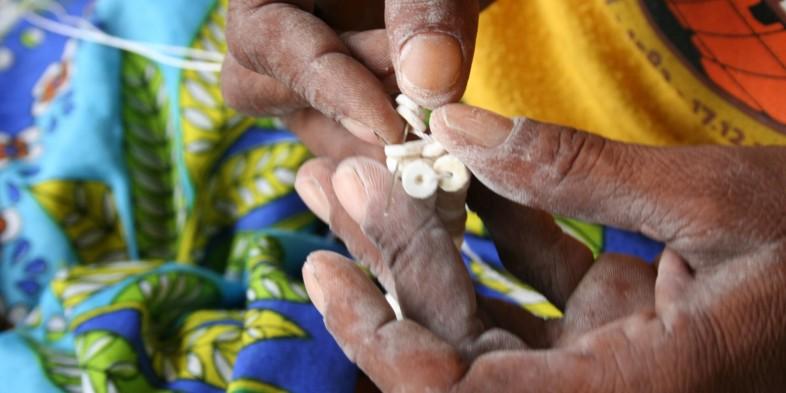 cropped-ju-huansi-san-woman-creating-an-ostrich-eggshell-bead-bracelet-in-the-naye-naye-conservancy-namibia.jpg